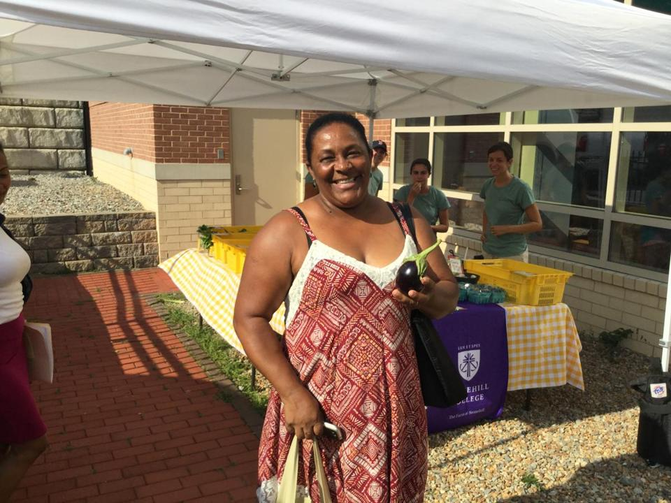 Brockton resident Maria Miranda with an eggplant purchased from the Mobile Market.