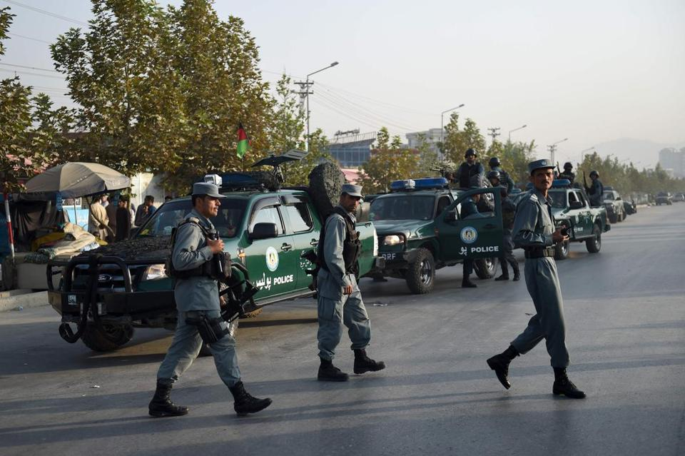 Afghan security personnel walk near the site following the militants' raid that targeted the elite American University of Afghanistan, in Kabul on August 25, 2016. At least nine people were killed after militants stormed the American University of Afghanistan in Kabul, officials said, in a nearly 10-hour raid that prompted anguished pleas for help from trapped students. / AFP PHOTO / WAKIL KOHSARWAKIL KOHSAR/AFP/Getty Images