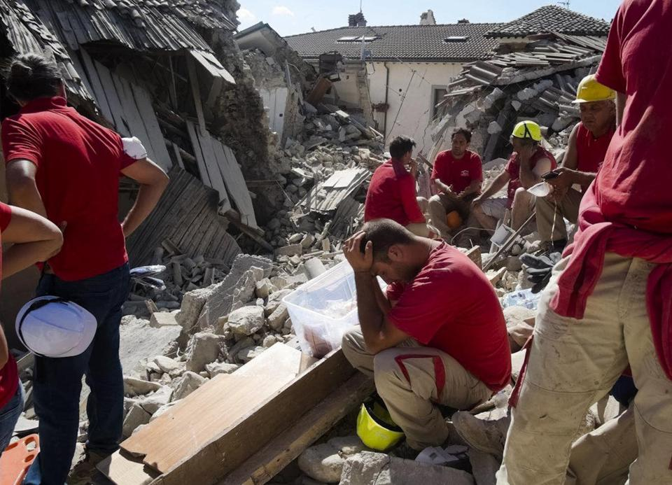 Rescuers pause in Amatrice, central Italy, where a 6.1 earthquake struck just after 3:30 a.m., Wednesday, Aug. 24, 2016. The quake was felt across a broad section of central Italy, including the capital Rome where people in homes in the historic center felt a long swaying followed by aftershocks. (AP Photo/Emilio Fraile)