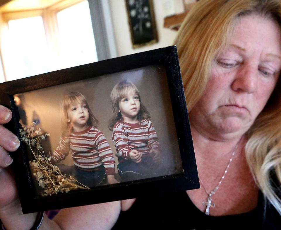 Sherri Smith held an early photo of her twin sons, Jesse and Tony Sparks, both of whom died from accidental drug overdoses.