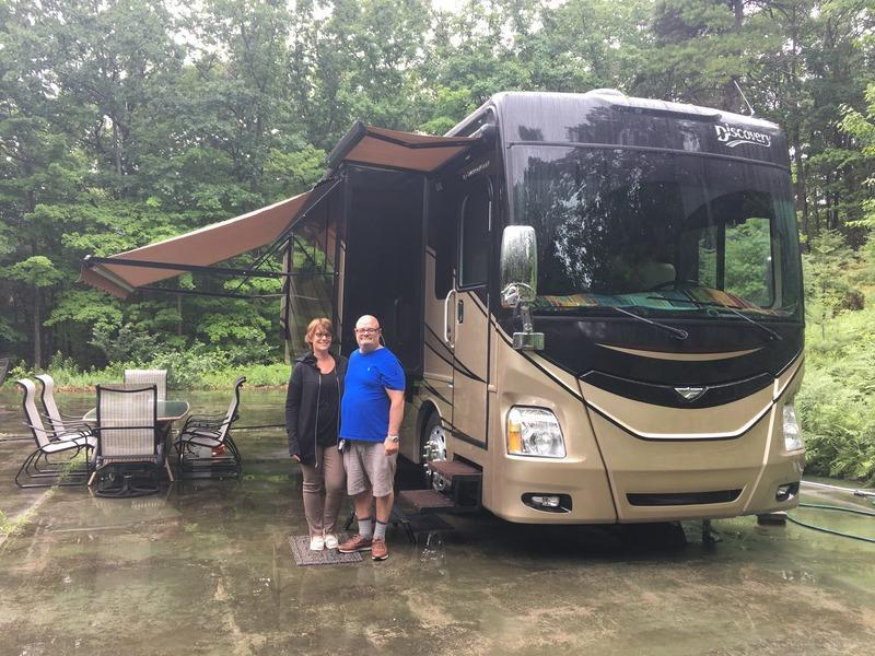 The author's parents outside their motor home.