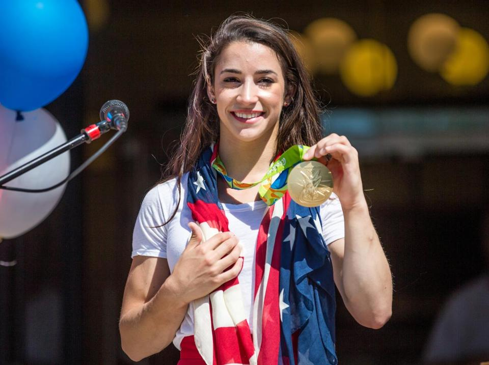 08/27/2016 NEEDHAM, MA Aly Raisman (cq) shows the crowd her gold medal during a rally for Olympic champion gymnast in the Town Common of her hometown, Needham. (Aram Boghosian for The Boston Globe)