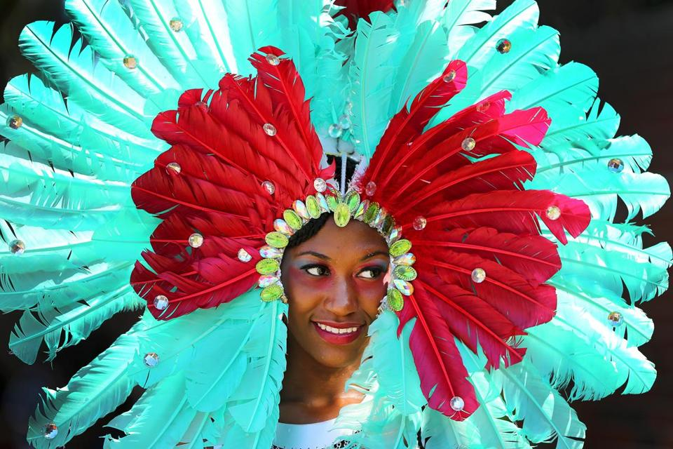 Boston-08/27/2016- The annual Caribbean Carnival Parade was held in Dorchester as costumed marchers assembled on Martin Luther King Blvd. The parade with hundreds of marchers and dozens of floats ended at Franklin Park. Natalia Brown with the Royalty group wears aqua feathers in her headdress. Boston Globe staff photo by John Tlumacki(metro)
