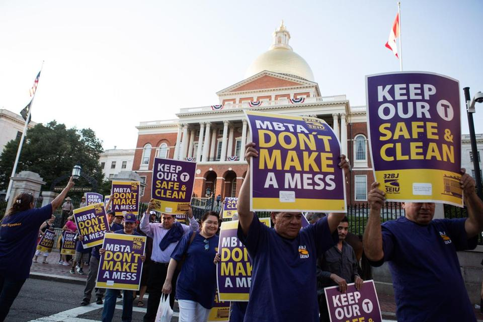 Members of the MBTA Union 32/ Boston Janitors Service Employees International Union protested outside the State House on Aug. 28.