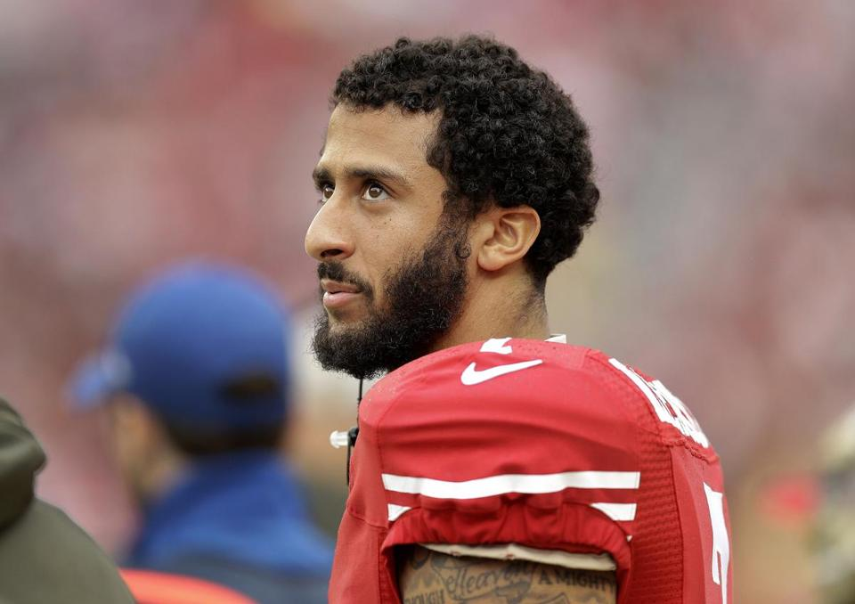 FILE - In this Nov. 8, 2015, file photo, San Francisco 49ers quarterback Colin Kaepernick stands on the field during an NFL football game against the Atlanta Falcons in Santa Clara, Calif. Kaepernick's protest of the national anthem over what he describes as oppression of minorities in the United States is apparently winning support from some veterans on Twitter under #VeteransForKaepernick. Kaepernick said he'll continue the protest during San Francisco's preseason game at San Diego on Thursday, Sept. 1, 2016. (AP Photo/Ben Margot, File)