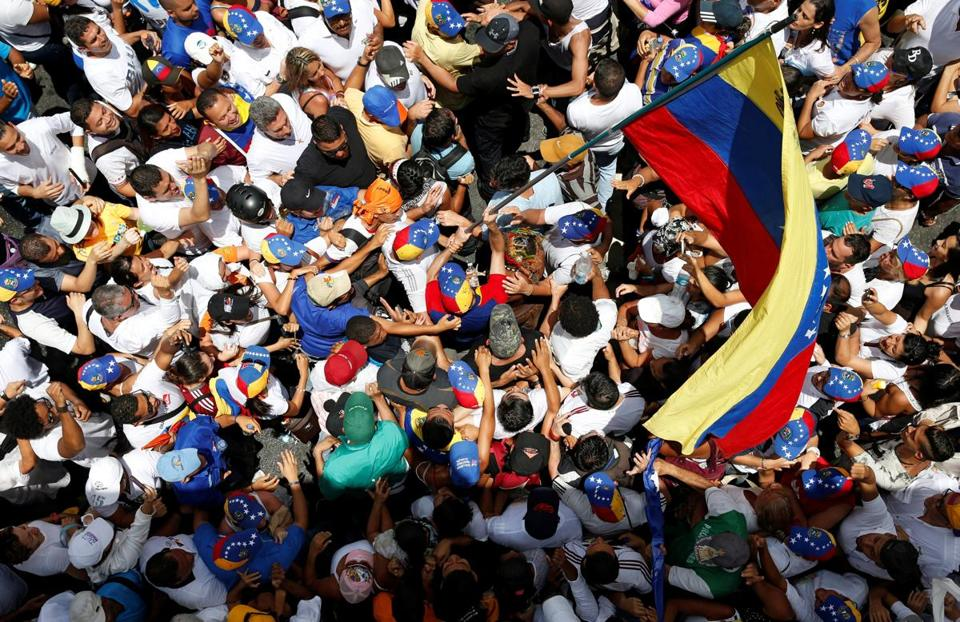 Thursday's protest, the largest in years, filled dozens of city blocks in Caracas, and the opposition promised more actions.