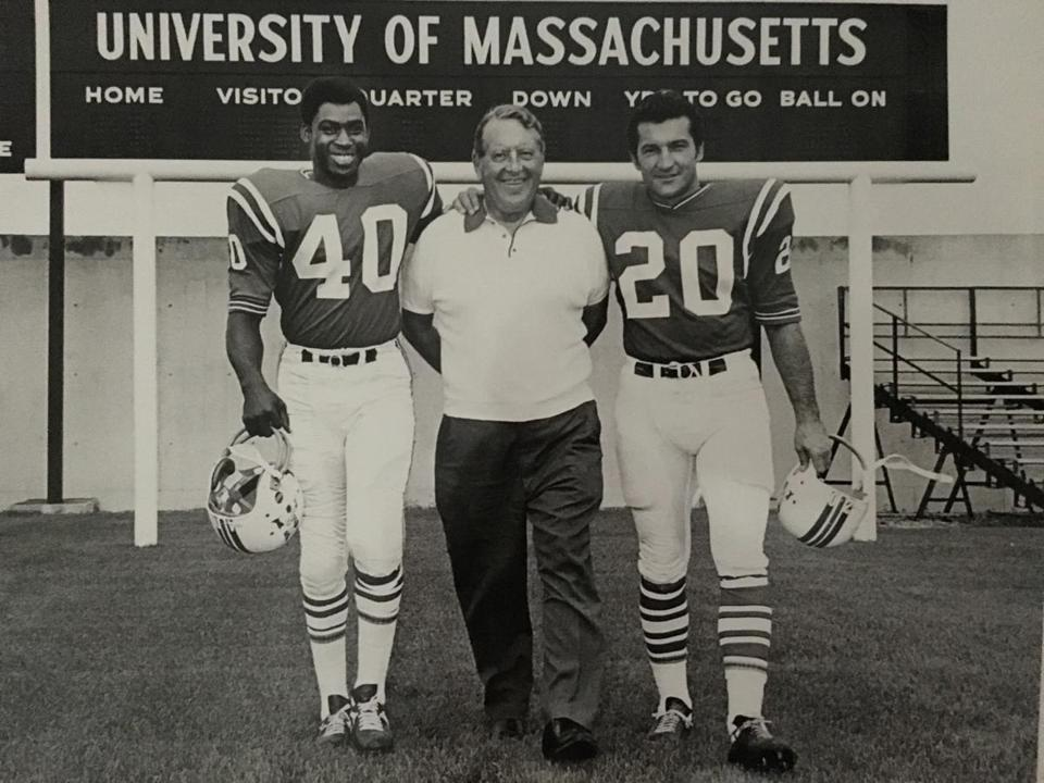 Larry Garron (left) and Gino Cappelletti flank the Patriots' first PR man, Gerry Moore, during a pre-season training camp in the early 1960s.