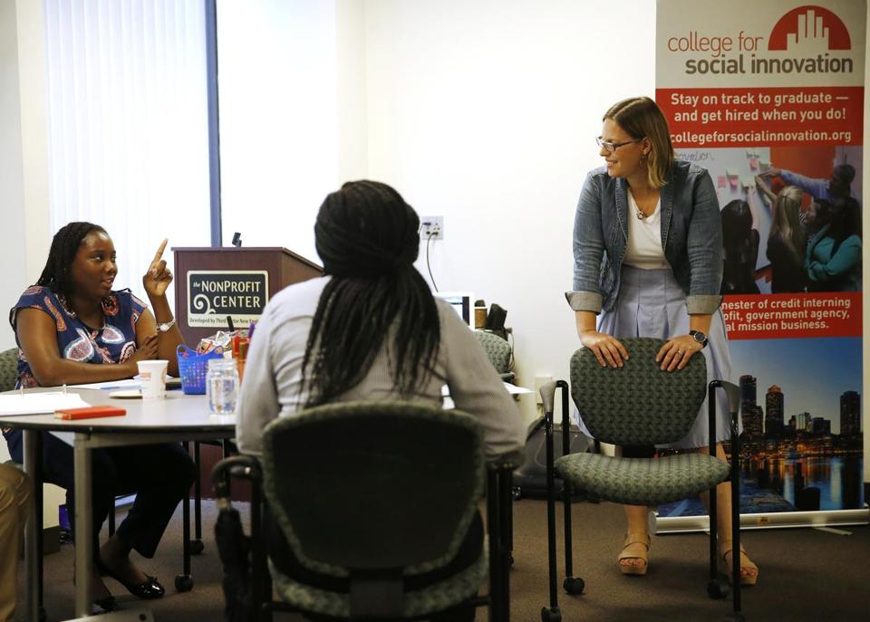 Student Danique Montique (left) spoke to chief program officer Ariel Brooks at the College for Social Innovation.
