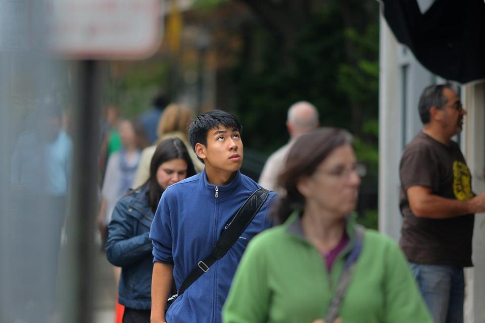 Kevin Yang, walking along Brattle Street on his way to a Harvard University library, benefited from the Harvard Ed Portal mentorship program for students in Allston and Brighton.