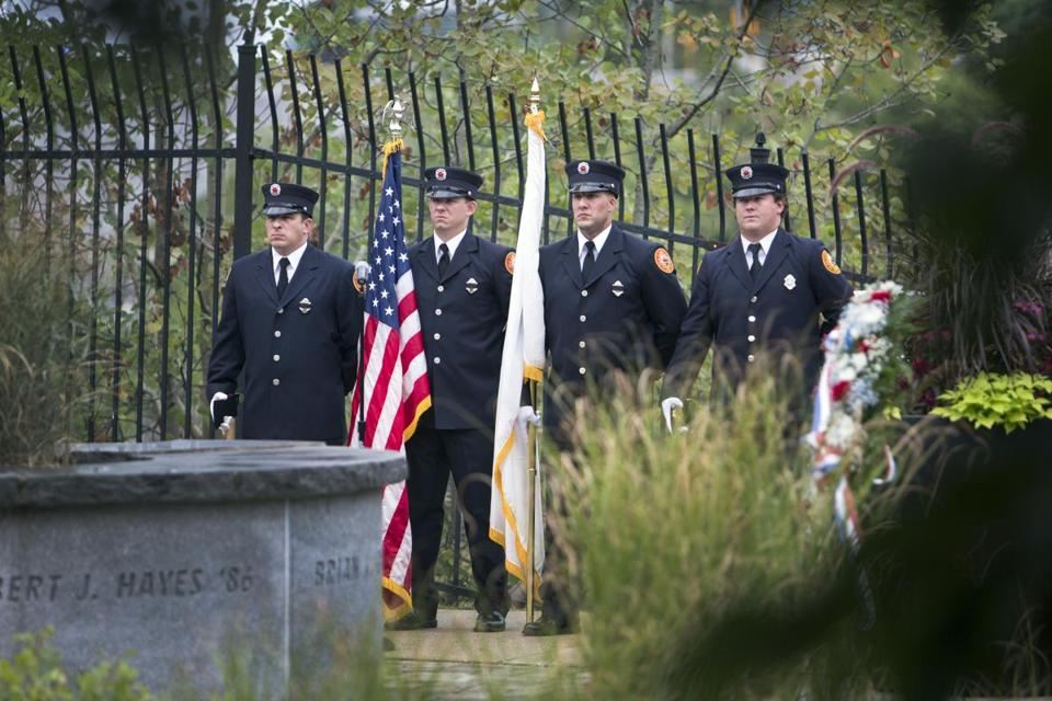10victims - September 9, 2016 | Lowell, MA Lowell Fire Department Honor Guard stands before the memorial during the ceremony. UMass Lowell honor's the seven members of the university community who were among the victims of the terrorist attacks on Sept. 11, 2001 with a ceremony marking the 15th anniversary of the tragedy, on the banks of the Merrimack River. (Kieran Kesner for The Boston Globe)