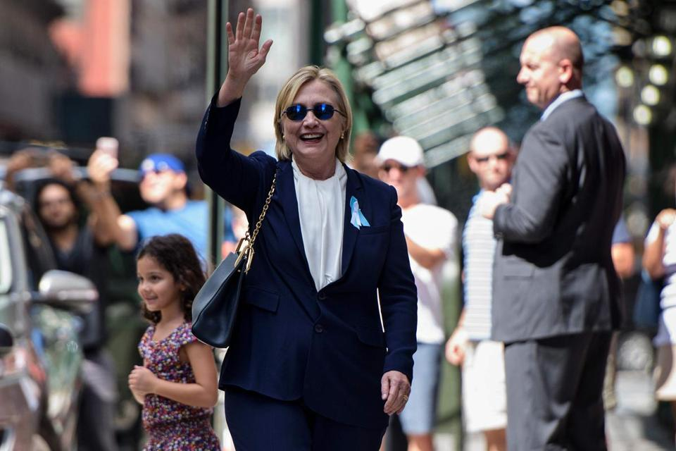 "US Democratic presidential nominee Hillary Clinton waves to the press as she leaves her daughter's apartment building after resting on September 11, 2016, in New York. Clinton departed from a remembrance ceremony on the 15th anniversary of the 9/11 attacks after feeling ""overheated,"" but was later doing ""much better,"" her campaign said. / AFP PHOTO / Brendan SmialowskiBRENDAN SMIALOWSKI/AFP/Getty Images"