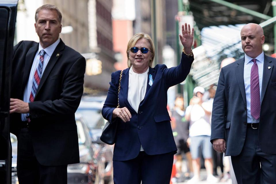 "US Democratic presidential nominee Hillary Clinton waves to the press as she leaves her daughter's apartment building after resting on September 11, 2016 in New York. Clinton departed from a remembrance ceremony on the 15th anniversary of the 9/11 attacks after feeling ""overheated,"" but was later doing ""much better,"" her campaign said. / AFP PHOTO / Brendan SmialowskiBRENDAN SMIALOWSKI/AFP/Getty Images"