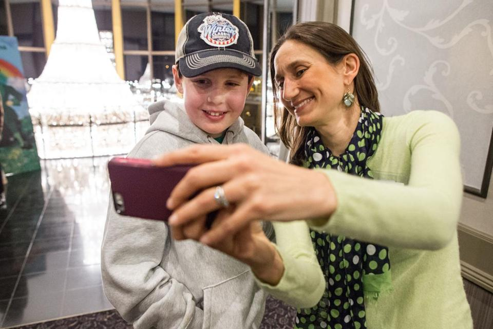 "FOR WILL LACEY PROJECT only--- 03/07/2015 RANDOLPH, MA Will Lacey (cq) (left) took a selfie with Dr. Giselle Sholler (cq) during the ""Cure Me I'm Irish"" fundraiser for BeatNB, held at Lombardo's in Randolph. (Aram Boghosian for The Boston Globe)"