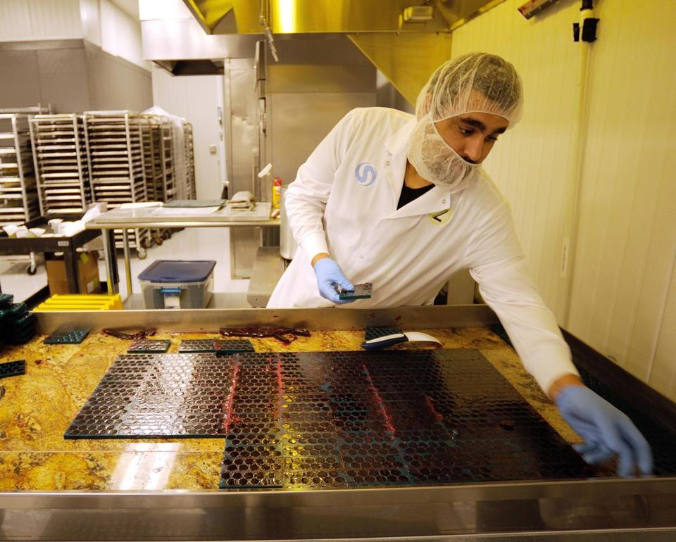 Production lead John Decker removed candy molds filled with finished nuggets at the Zoots marijuana edibles production facility in Denver.