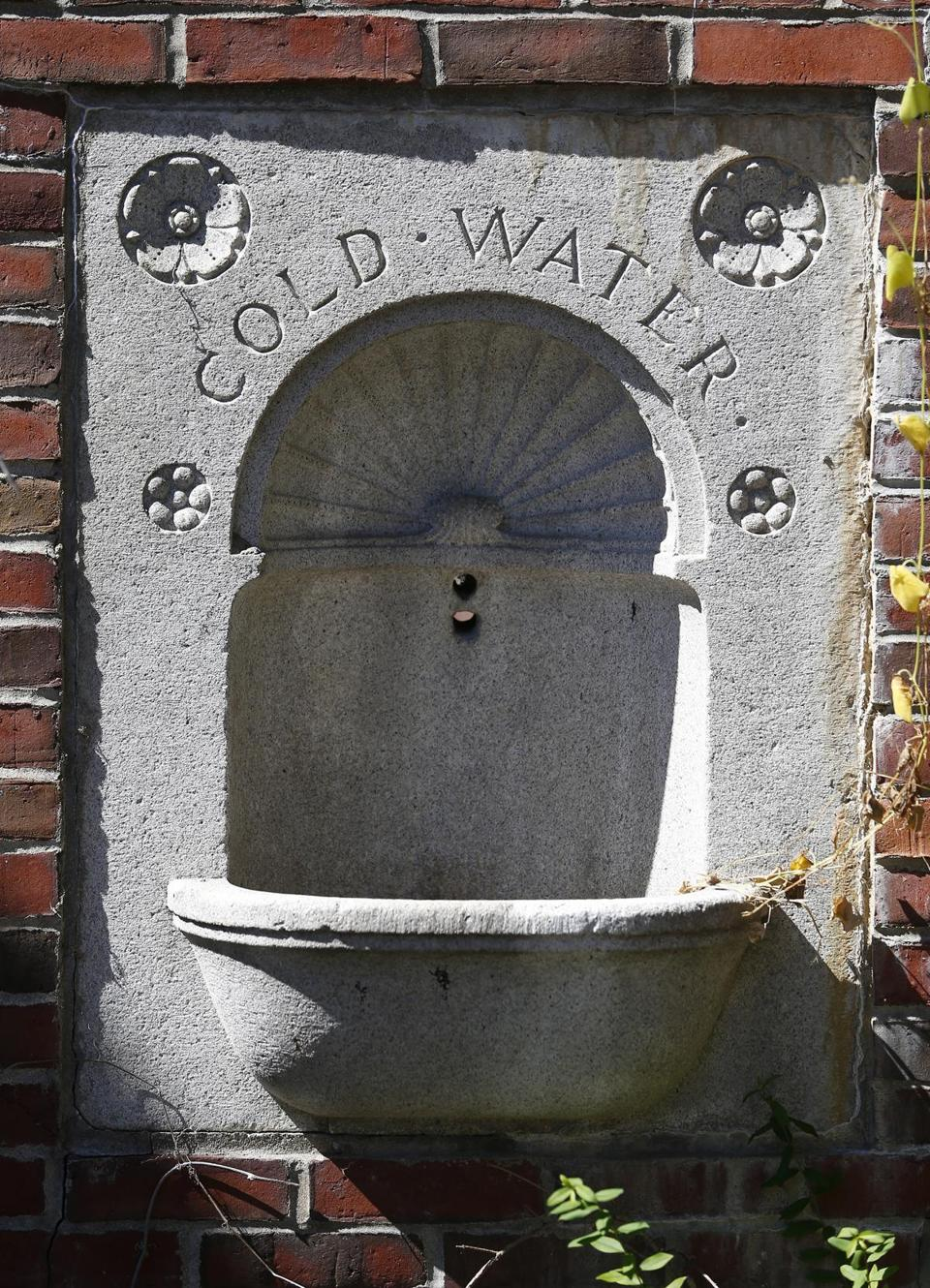 Among the unusual artifacts on the grounds is a drinking fountain basin embedded in a brick archway.