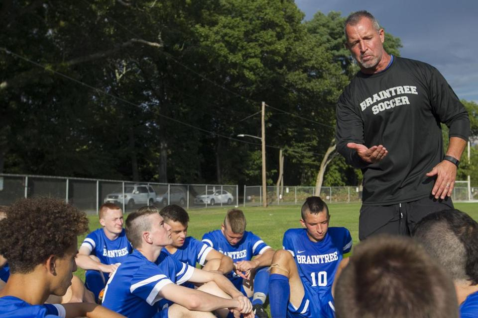 Braintree High School head soccer coach Gary Burke (R) talks to his players after the first half against Framingham High School at Framingham High School in Framingham, Massachusetts on September 14, 2016. Matthew Healey for The Boston Globe