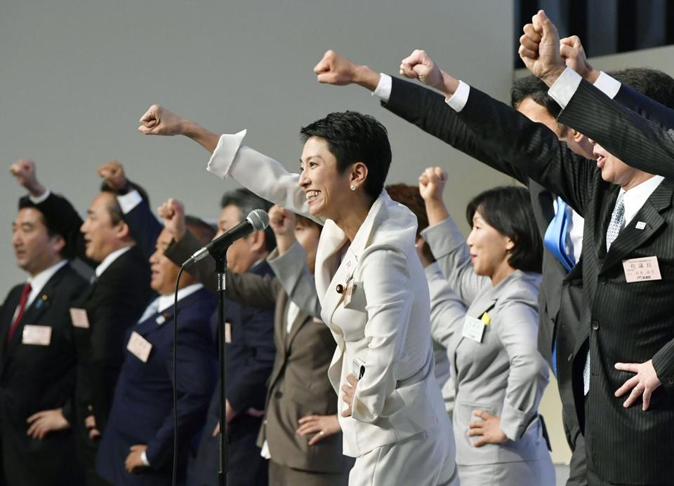 Democratic Party leader Renho Murata raised a clenched fist with other party members after her election Thursday.