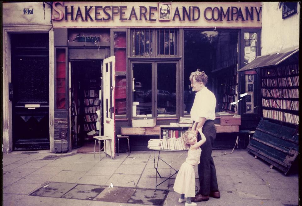 "Shakespeare and Company owner George Whitman and his daughter Sylvia in front of the Paris bookstore in 1984 from ""Shakespeare and Company, Paris: A History of the Rag & Bone Shop of the Heart."""