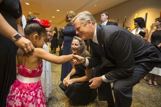 Governor Charlie Baker and his wife, Lauren, meet Alyssa (a patient from Boston Children's Hospital) at the 7th annual Milagros Para Ninos Gala benefiting the hospital.