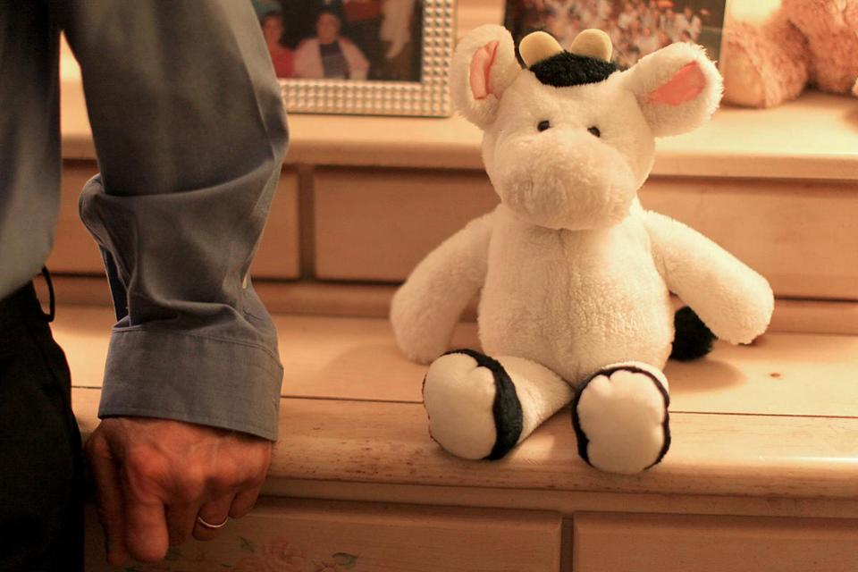 This is the first stuffed animal the Siracusas' daughter ever received -- in her bedroom with her father standing next to it.