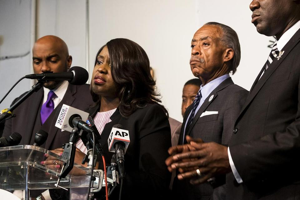 Tiffany Crutcher, the twin sister of Terence Crutcher, with the Rev. Al Sharpton during a news conference Wednesday.