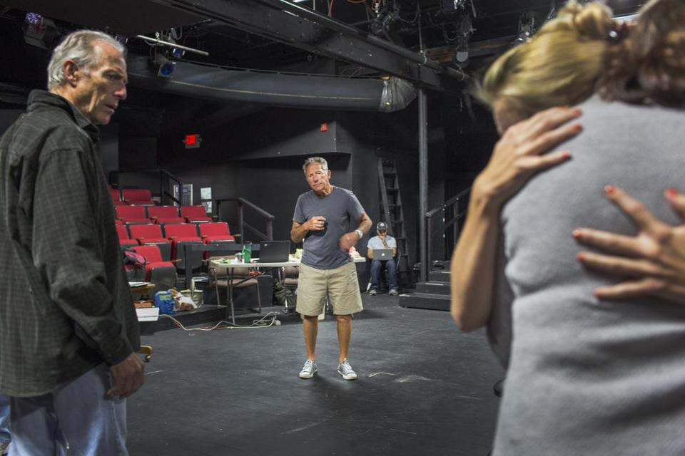 "Playwright and director Israel Horovitz (standing center) in rehearsal for ""Man in Snow"" with actor Will Lyman (left) and other cast members at Gloucester Stage Company."
