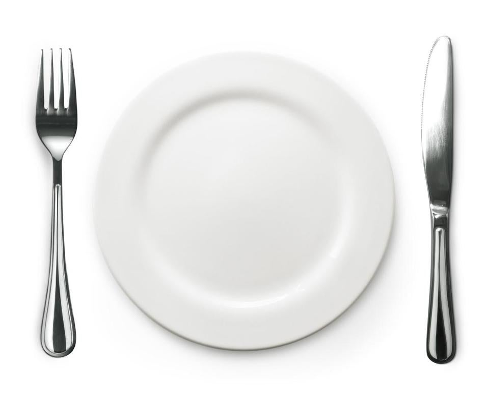 Photo of the fork and knife with white plate on white background; Shutterstock ID 127668632; PO: oped
