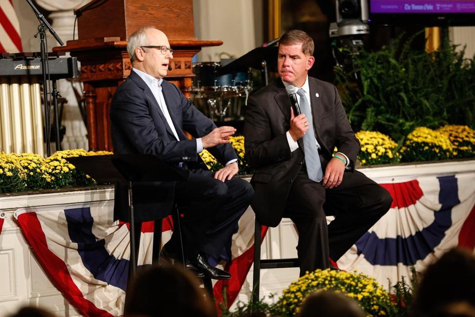 Harvard professor Michael Sandel spoke with Boston Mayor Marty Walsh on Monday during a HUBweek forum in Faneuil Hall.