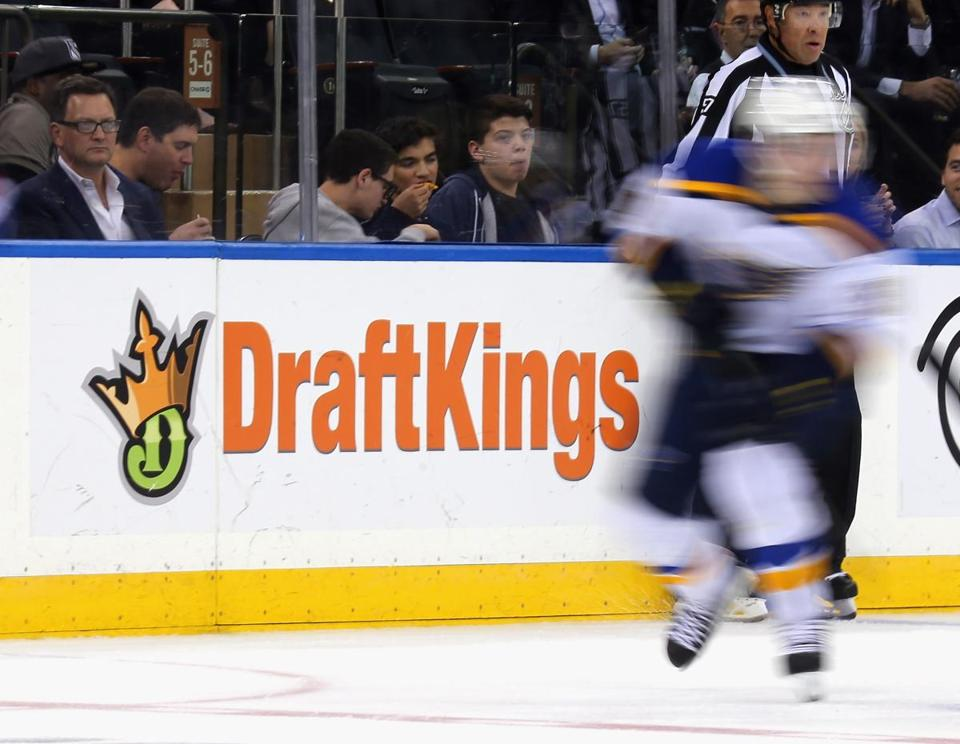 NEW YORK, NY - NOVEMBER 12: The New York Rangers and St. Louis Blues skate in front of a dasher board advertising the betting website DraftKings at Madison Square Garden on November 12, 2015 in New York City. (Photo by )