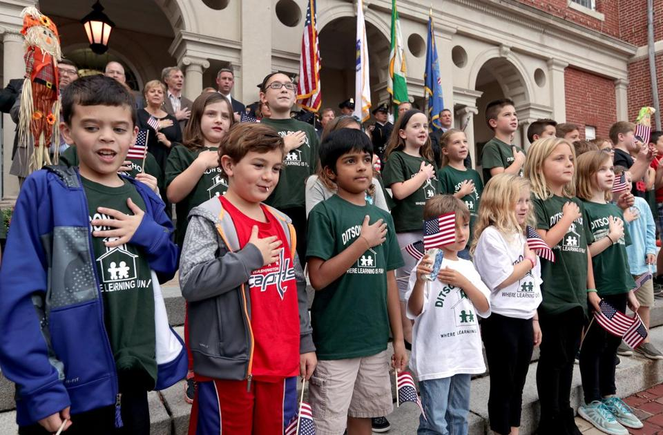 Billerica, MA: 09-27-2016: Students from the Ditson Elementary School lead the Pledge of Alleiance during ceremonies outside the Billerica (Mass.) Public Library where Billerica was officially declared the Yankee Doodle Town Sept. 27, 2016. Photo/John Blanding, Boston Globe staff story/, Metro ( 28yankeedoodle )