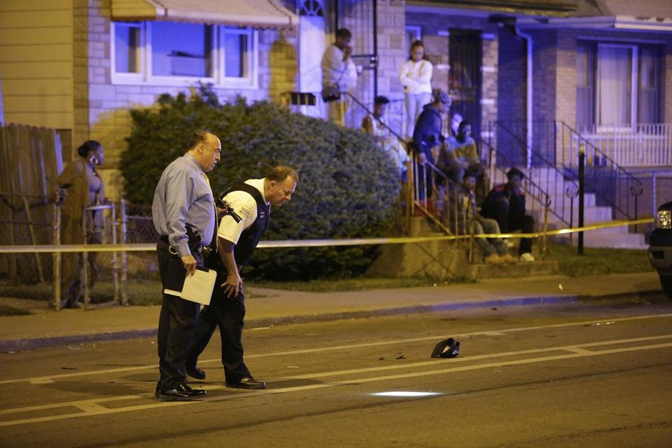 A Chicago shooting investigation in 2015. Murder in Chicago is down 17 percent in 2018 relative to 2017.