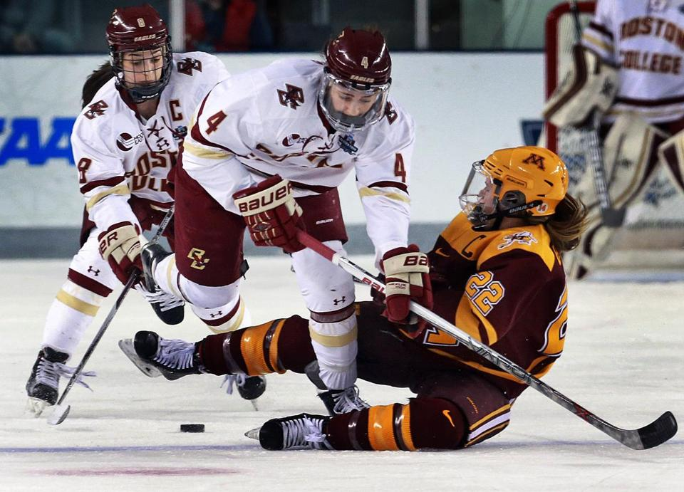 03/12/16: Durham, NH: BC's Megan Keller (4) tangles with Minnesota's Hannah Brandt (22), with the Eagles Dana Trivigno (8) waiting to pick up the loose puck behind them. The Boston College women's ice hockey team met Minnesota in the Championship Game of the NCAA Frozen Four hockey tournament at the Whittemore Center on the campus of the University of New Hampshire. (Globe Staff Photo/Jim Davis) section:sports topic:bc-minnesota