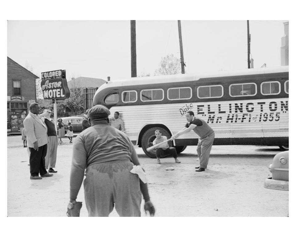 "Charlotte Brooks's ""Duke Ellington and band members playing baseball in front of their segregated motel while touring in Florida"" (1955)."