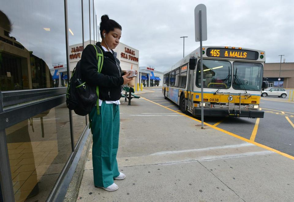 Dania Matos awaited her Uber ride to class after taking an MBTA bus to the North Shore Mall.