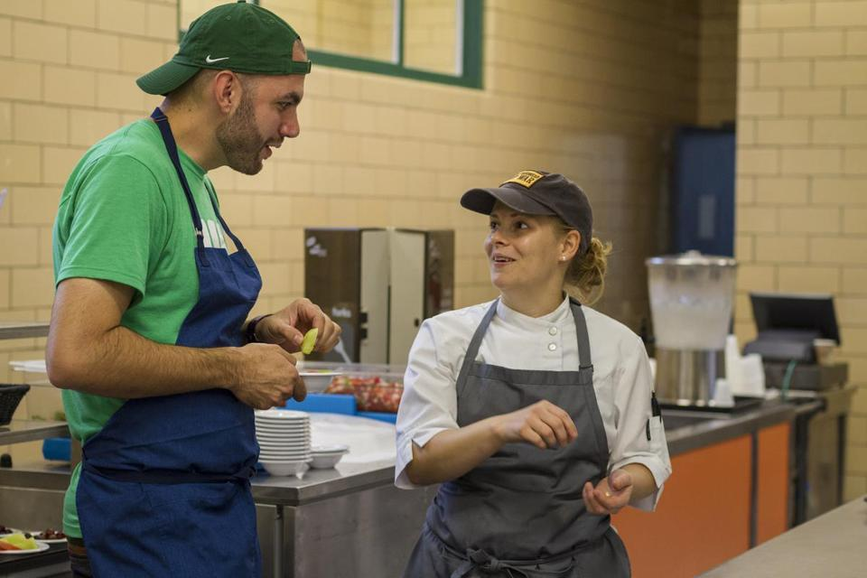 Daniel Giusti (with chef April Kindt) runs the school lunch programs in New London, Conn., where has made changes to the quality of food as well as the presentation of it.