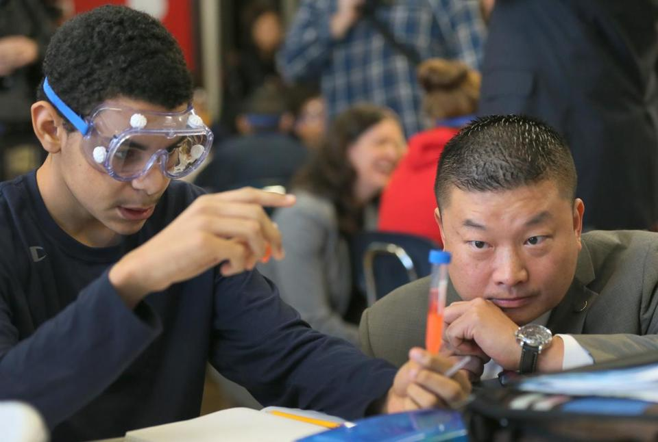 Joel Latimer showed his science laboratory project to Superintendent Tommy Chang at the Oliver Hazard Perry School on Monday. The school is one of 36 in Boston focusing on science, technology, engineering, and math learning this week.