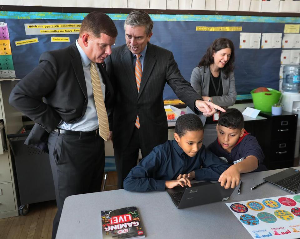 Mayor Martin J. Walsh and Boston School Committee Chairman Michael O'Neill looked over students working.