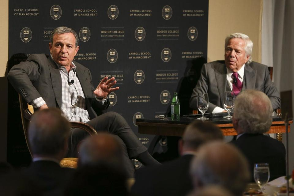 The Walt Disney Company's CEO Robert Iger speaks with New England Patriots owner Robert Kraft during a talk hosted by the Boston College CEO Club in Boston.
