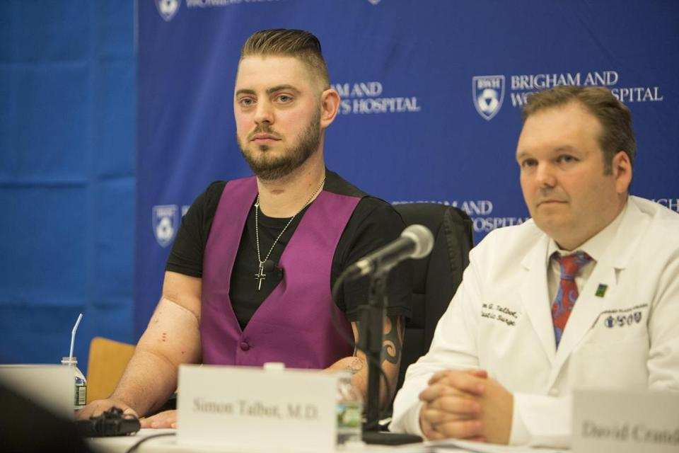 John Peck (left) and Dr. Simon Talbot listened during the press event at Brigham and Womens Hospital.