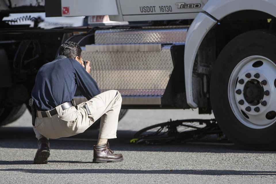 A State Trooper photographed a bicycle underneath a tractor-trailer at the scene.