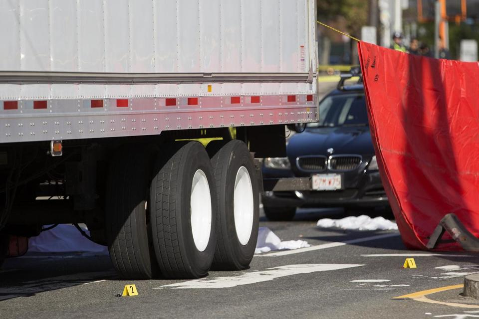 In the aftermath of the collision, two separate sheets were placed on the street at the scene.