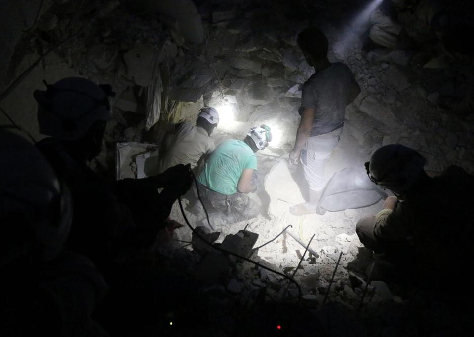 The White Helmets search for victims after a government airstrike in Aleppo on Oct. 4.