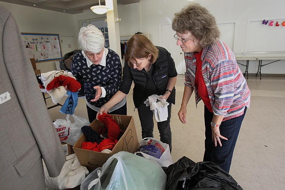 Volunteers (from left) Amanda Mujica, Susan Smith, and Holly Stratford collected winter clothes at Plymouth Congregational Church.