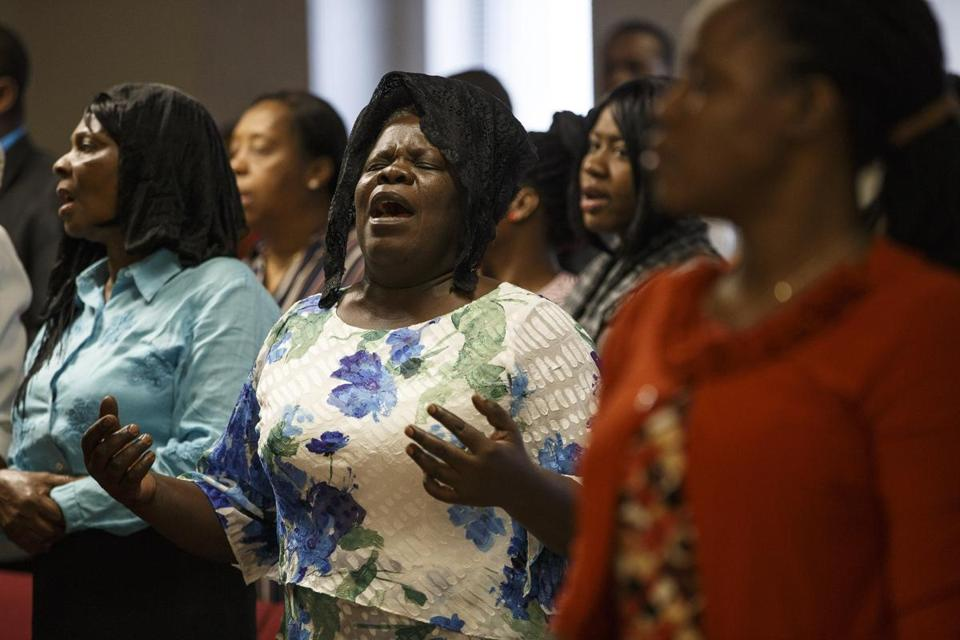 Congregants prayed during services at Boston's First Christian Church Source of Grace, a church frequented by the Haitian community, last month.