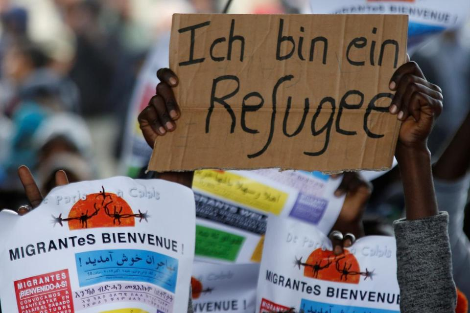 A migrant held a sign aloft during a protest last week near a refugee camp in Calais.