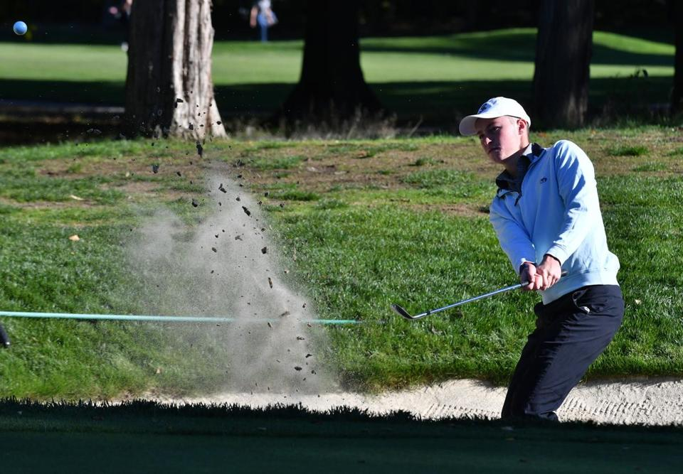 St. John's Prep golfer Chris Francoeur hits from a sand trap on the third hole at the Salem Country Club during SJP's matchup wth Xaverian. Josh Reynolds for The Boston Globe (NoWk, mullen)