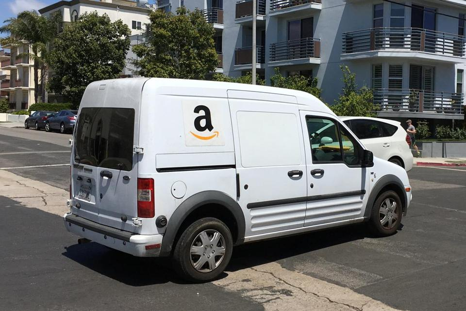 A local civil rights group accused Amazon.com of illegally using criminal background checks as the sole basis for firing dozens of Boston-area delivery drivers, most of them black and Latino.