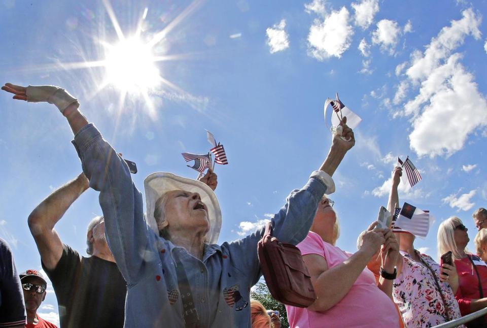 Ernestine Cuellar, of Charlestown, raised her hands in prayer during a rally on Boston Common on Aug. 30. The event was conducted by evangelist Franklin Graham as part of a tour to urge evangelicals to vote.