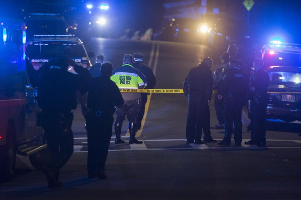 Police block a road near where 2 officers were shot in a firefight leaving a suspect dead in East Boston on Wednesday, October 12, 2016. (Scott Eisen for The Boston Globe)