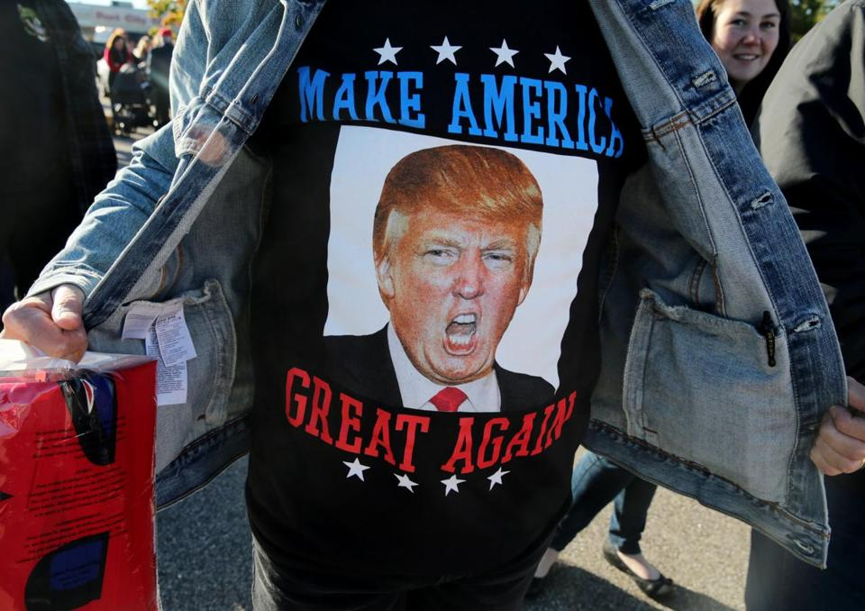 Gary Sonia, a Donald Trump supporter, showed off his T-shirt before entering Saturday's rally in Portsmouth, N.H.